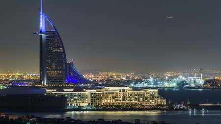 Dubai skyline with villas nad Burj Al Arab night timelapse.  Top view from atlantis on palm jumeirah. Éditoriale
