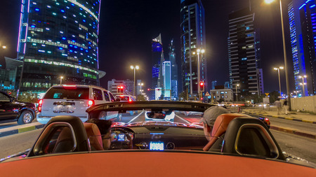 KUWAIT - CIRCA MARCH 2017: Drive through the traffic in the city highway timelapse hyperlapse drivelapse on convertible in Kuwait. Kuwait, Middle East Reklamní fotografie