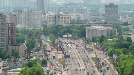 Top view of Traffic on the elevated road timelapse overpass on Yaroslavl highway Ostankino tv tower on background in Moscow, Russia 4K