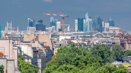 Panorama of Paris timelapse with modern skyscrapers. View from observation deck of Arab World Institute (Institut du Monde Arabe) building. Top aerial view. Green trees, Seine river, Blue cloudy sky at summer day. France. Foto de archivo