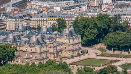 Top view of Paris skyline from above timelapse. Main landmarks of european megapolis with The Luxembourg Garden. Bird-eye view from observation deck of Montparnasse tower. Paris, France