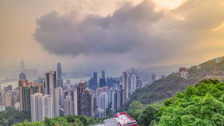 The famous view of Hong Kong from Victoria Peak timelapse. Taken at sunrise while the sun climbs over Kowloon Bay. The density of high-rise buildings is obvious in this shot. 4K