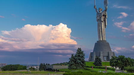 Mother Motherland monument - part of Museum of the Great Patriotic War timelapse at sunset time in Kiev, Ukraine 4K
