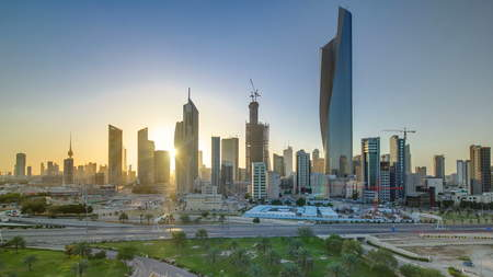 Top view of Kuwait cityscape during the sunset timelapse with modern skyscrapers