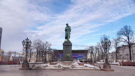 Monument to russian poet Alexander Pushkin on Pushkin Square winter timelapse hyperlapse, Moscow, Russia 4K
