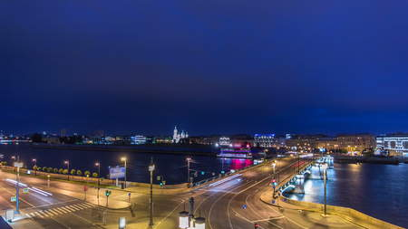 Malaya Neva river. Birzhevoy (Exchange) Bridge and traffic at night timelapse. Top view form roof. St.-Petersburg, Russia Stock Photo