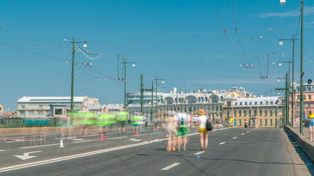 Birzhevoy Bridge timelapse. XXVII International marathon in Saint Petersburg , Russia. People run on the bridge.