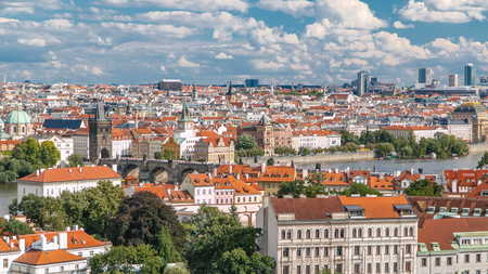 Panorama of Prague Old Town with red roofs timelapse, famous Charles bridge and Vltava river, Czech Republic. View from above near Prague castle 版權商用圖片 - 109196659