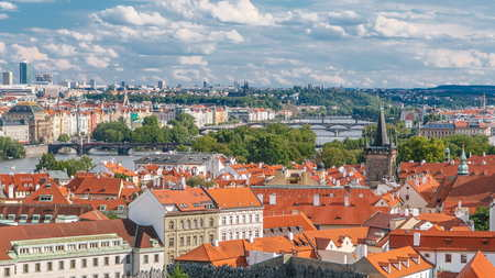 Panorama of Prague Old Town with red roofs timelapse, famous bridges and Vltava river, Czech Republic. View from above near Prague castle 版權商用圖片 - 109196655