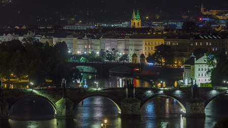Scenic view of bridges on the Vltava river night timelapse and of the historical center of Prague: buildings and landmarks of old town with Charles bridge and multi-coloured walls. 版權商用圖片