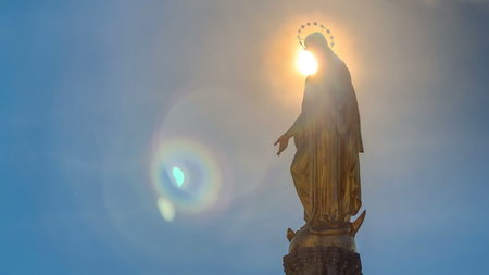 Holy Mary monument with sun behind it on square in front of the Cathedral timelapse in Zagreb, Croatia. Blue sky at sunny day. Close up view