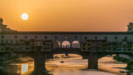 Sunset view of Florence Ponte Vecchio over Arno River in Florence timelapse, Italy. Florence architecture. One of the main landmarks in Florence. Close up