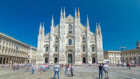 The Duomo cathedral timelapse hyperlapse. Front view with people walking on square. The Gothic cathedral took nearly six centuries to complete. It is the fifth largest cathedral in the world and the largest in italy Editorial