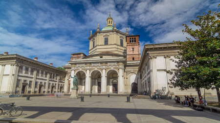 Facade of San Lorenzo Maggiore Basilica timelapse hyperlapse(Saint Lawrence the Major Cathedral) and statue of Constantine emperror in front. Blue cloudy sky at summer day. Nice travel destination