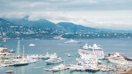 Monte Carlo city aerial panorama timelapse. Port Hercule. View of luxury yachts and buildings in harbor of Monaco, Cote dAzur.