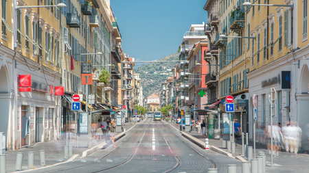 View of Place Garibaldi timelapse with trams on the street and traffic. It is named after Giuseppe Garibaldi, hero of Italian unification (born in Nice). Place Garibaldi is monumental example of Baroque architecture.