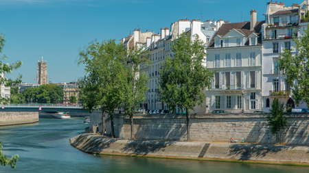 Saint-Louis bridge timelapse with houses on Orleans embankment. Two islands on the River Seine in Paris, France, called Ile de la cite and Ile saint Louis. Paris, France.