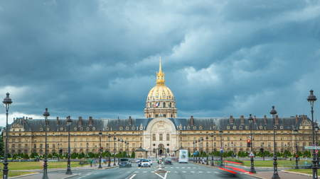 Traffic jam in front of Les Invalides timelapse in Paris, France. Dramatic clouds at summer day. Street lights on both sides