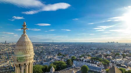 Panorama of Paris timelapse with Eiffel tower, France. Top view from Sacred Heart Basilica of Montmartre (Sacre-Coeur). Sunny day with blue cloudy sky. Фото со стока