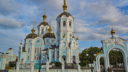 Orthodox temple of saint Alexander in city Kharkiv (Ukraine) timelapse hyperlapse. Church in a summer day on a blue cloudy sky background.