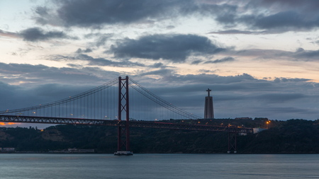 Lisbon city before sunrise with April 25 bridge night to day , Cristo Rei and lighthouse early morning 免版税图像