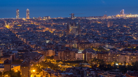 Panorama of Barcelona night to day , Spain, viewed from the Bunkers of Carmel on a cloudy morning before sunrise.