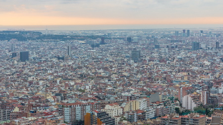 Panorama of Barcelona during sunrise , Spain, viewed from the Bunkers of Carmel on a cloudy morning with rays of light. Aerial top view from hill. Colorful sky