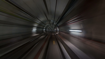 Fast speed moving in the subway tunnel with light trails inside   drivelapse. Barcelona metro 免版税图像