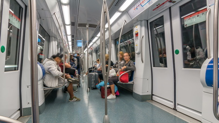 BARCELONA, SPAIN - CIRCA OCTOBER 2018: People travel by Metro in Barcelona , Spain. View inside of modern subway car