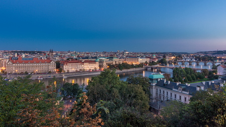 Evening Panorama of Prague with Vltava river and Prague Bridges day to night transition timelapse. Top view from Hanavsky pavilion 免版税图像