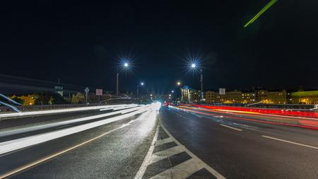 Traffic on the Jiraskuv Bridge over the still waters of the River Vltava in the centre of Prague timelapse, Czech Republic. Street light on sides