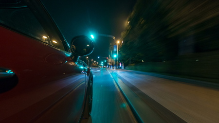 Car moves at fast speed at the night streets timelapse hyperlapse drivelapse. Blured road with lights reflected from car on high speed. Prague, Czech Фото со стока