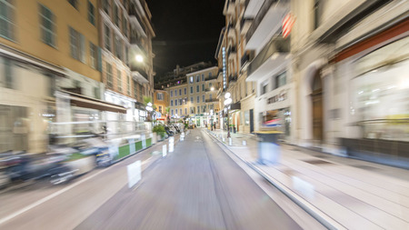 Driving on the night streets in Nice timelapse hyperlapse drivelapse, France. The road illuminated on the promenade and other places