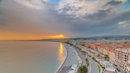 Sunset over Nice city and Mediterranean Sea aerial timelapse. Bay of Angels with dramatic sky from Castle viewpoint, Cote d'Azur, French Riviera, France Standard-Bild - 116236977