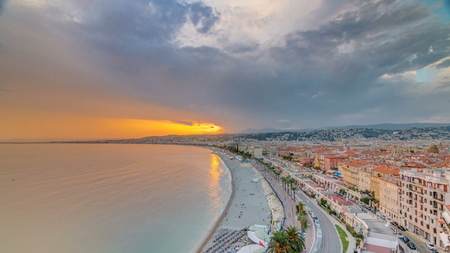 Sunset over Nice city and Mediterranean Sea aerial timelapse. Bay of Angels with dramatic sky from Castle viewpoint, Cote d'Azur, French Riviera, France Standard-Bild - 116236991