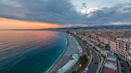 Panorama over Nice city and Mediterranean Sea aerial day to night transition timelapse. Bay of Angels with dramatic sky from Castle viewpoint, Cote d'Azur, French Riviera, France Standard-Bild - 116236992