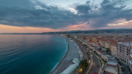 Panorama over Nice city and Mediterranean Sea aerial day to night transition timelapse. Bay of Angels with dramatic sky from Castle viewpoint, Cote d'Azur, French Riviera, France Standard-Bild - 116236993