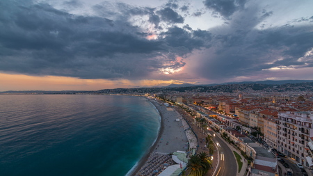 Panorama over Nice city and Mediterranean Sea aerial day to night transition timelapse. Bay of Angels with dramatic sky from Castle viewpoint, Cote d'Azur, French Riviera, France Standard-Bild - 116236996