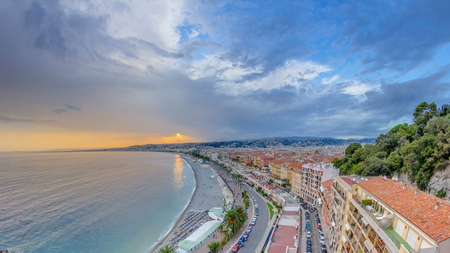 Sunset over Nice city and Mediterranean Sea aerial timelapse. Bay of Angels with dramatic sky from Castle viewpoint, Cote d'Azur, French Riviera, France Standard-Bild - 116236999