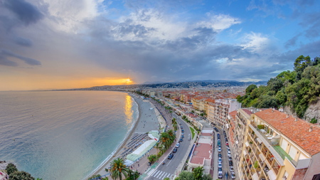 Sunset over Nice city and Mediterranean Sea aerial timelapse. Bay of Angels with dramatic sky from Castle viewpoint, Cote d'Azur, French Riviera, France Standard-Bild - 116237000