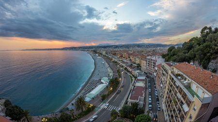 Panorama over Nice city and Mediterranean Sea aerial day to night transition timelapse. Bay of Angels with dramatic sky from Castle viewpoint, Cote d'Azur, French Riviera, France Standard-Bild - 116237002