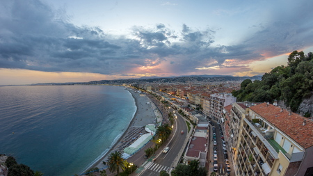 Panorama over Nice city and Mediterranean Sea aerial day to night transition timelapse. Bay of Angels with dramatic sky from Castle viewpoint, Cote d'Azur, French Riviera, France Standard-Bild - 116237003