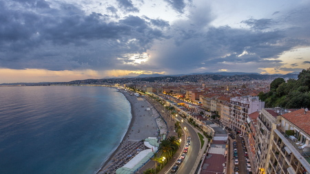 Panorama over Nice city and Mediterranean Sea aerial day to night transition timelapse. Bay of Angels with dramatic sky from Castle viewpoint, Cote d'Azur, French Riviera, France Standard-Bild - 116237005