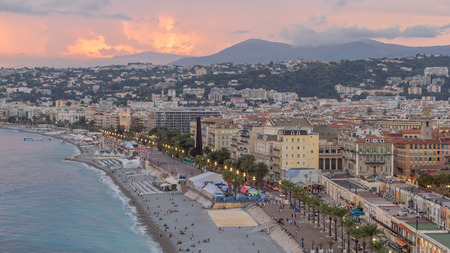 Panorama over Nice city and Mediterranean Sea aerial day to night transition timelapse. Bay of Angels with dramatic sky from Castle viewpoint, Cote d'Azur, French Riviera, France Standard-Bild - 116237011