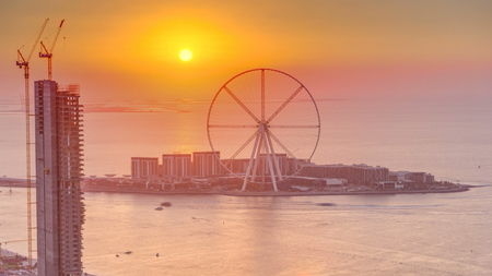 Bluewaters island at sunset aerial timelapse with ferris wheel, new walking area with shopping mall and restaurants, newly opened leisure and travel spot in Dubai