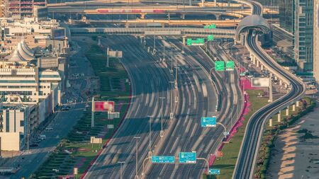 Sheikh Zayed Road at intersection of Hessa Street aerial timelapse from above before sunset, Dubai, United Arab Emirates. Sheikh Zayed Road is the main highway running through Dubai. 免版税图像