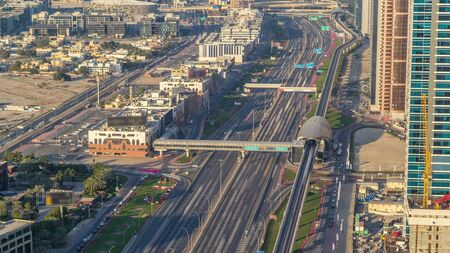 Sheikh Zayed Road at intersection of Hessa Street aerial timelapse from above before sunset, Dubai, United Arab Emirates. Sheikh Zayed Road is the main highway running through Dubai. Banco de Imagens