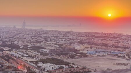 Panorama and aerial view of coastline Dubai at sunset timelapse, United Arab Emirates. Houses and villas from above Banco de Imagens
