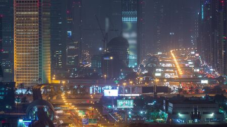 Dubai cityscape during sand storm night timelapse, aerial view of skyscrapers and traffic on sheikh zayed road from Zabeel district, United Arab Emirates Banco de Imagens