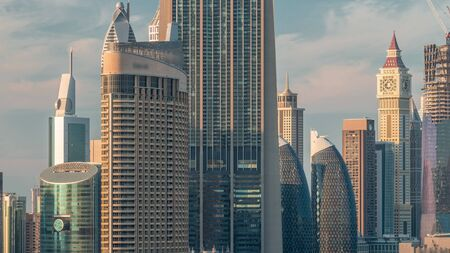 Aerial sunset cityscape with architecture of Dubai downtown and financial center timelapse, United Arab Emirates. Tallest towers and skyscrapers Stock Photo